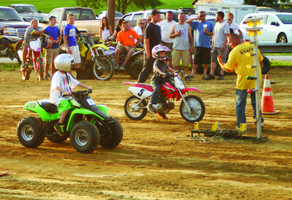 Troy Carter explained the rules of the ATV drag race to young competitors.