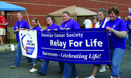 Survivors carry the banner for Relay For Life 2013.