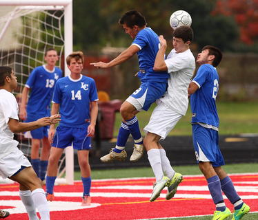LaRue Countys Raymundo Perez and Brandon Lucas go up for a header during quarterfinal play.