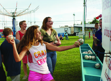 "Erin Salony, 14, threw a baseball in an attempt to knock ""Bobo the Clown"" off his perch in a dunking booth at the Fair."