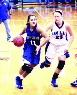 Sophomore guard Alexis Brewer, left, brings the ball down the court as junior Ivy Brown guards her during the intramural game.