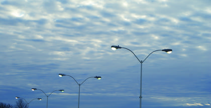 The lights in the parking lot at Lincoln Plaza remained on during an overcast winter morning.