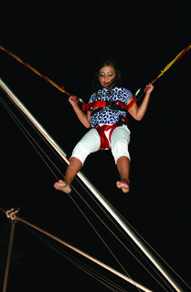 Ajia Jolie Ballard, 8, of Rineyville, bounced on the Hulk Bungee at the LaRue County Fair.