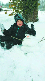 Bradley Laughner and snowman waving hello on W. Water Street in Hodgenville.