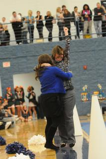 Megan Willard, cheerleading coach for LaRue County Middle School, left, and Renee Wright, assistant varsity coach, celebrate after learning both the middle school and varsity squads won their division. 