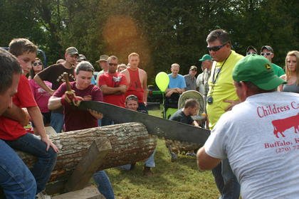 Heidi Mueller, from Illinois, and Bill Thomas from Hodgenville, work together to beat the record of 1 minute and 18 seconds, in the cross cut competition. The duo beat the record, cutting the log in only 27 seconds.