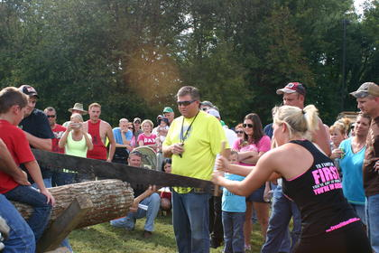 Lindsey Bell, right, and J.D. Rucker, left, work together to beat the clock during the cross-cut competition.