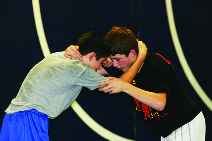 Dalton Bell, left, grappled with a Taylor County High School wrestler during last week's practice.