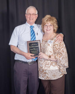 The 2016 President's Award went to David Harrison of Hodgenville. Harrison significant contributions to LaRue County in service, devotion, civic and service organizations, to his family, his church, as he unselfishly has given of himself to others through his community involvement. Harrison retired in January after serving for over 35 years as the LaRue County Extension Agent for agriculture and natural resources. Pictured with Harrison, is 2015-16 President Allison Shepherd.