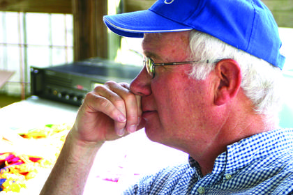 LaRue County Extension Agent David Harrison watched a contestant in the dairy cattle show.
