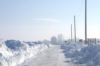 Snow on Logan Skaggs Road piled mailbox deep after being cleared.