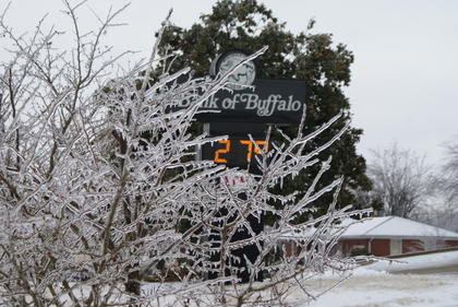 Bank of Buffalo thermometer said 27 degrees about noon, Wednesday.