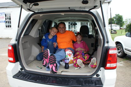 Sarah, Trevor and Kara Caswell ate breakfast in their van Saturday morning.