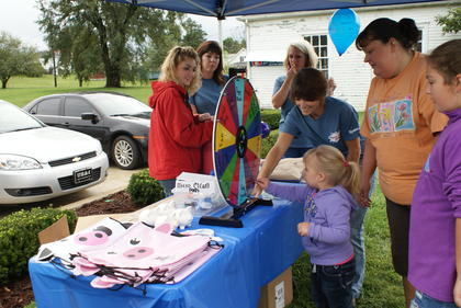 Keira Wheeler, 3, spun the wheel for a prize.