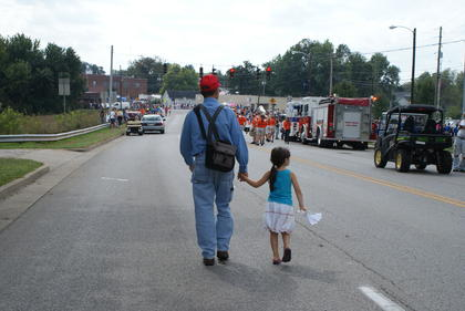 Bud Ireland and his granddaughter, Claire Higginbotham, walked toward downtown Hodgenville.