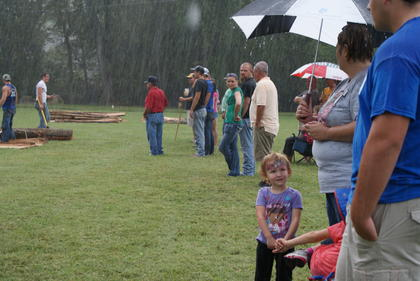 The railsplitting contests continued during a downpour Saturday.