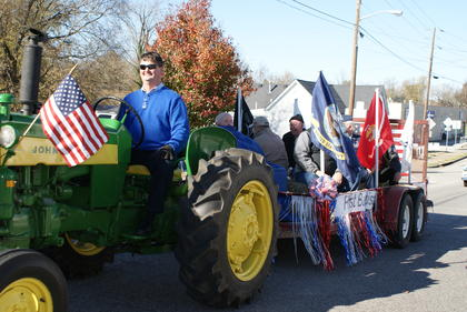 Veterans rode on a wagon in the parade. Doug Bell drove the tractor.