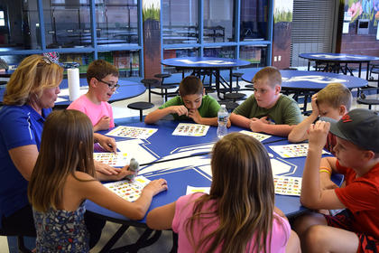 Expanded Food and Nutrition Education Program Assistant Patty Holbert spoke to students about fruits and vegetables during Cool School. Students were able to sample fresh pineapples, cherries and blueberries. They also participated in a fruit and vegetable identification activity. Pictured from the left clockwise, Patty Holbert, Tanner Skaggs, Aiden Meinen, Garret Dohn, Kevin Murray, Keaton Nall, Kaylea Dunn and Amelia Kudrna.