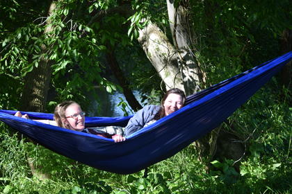 Hannah Harry and Elizabeth Ross hanging out in Ross' hammock.