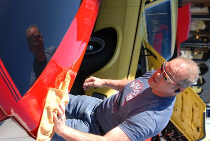 Mike Webb of Louisville polishes his 1986 Ford Mustang at the beginning of Saturday's car cruise. There were classic vehicles from every decade present at the Square.
