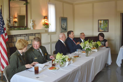 Seated at the head table during the Eisenhower dinner, hosted by the Hodgenville Woman's Club are from left, Sarah Craighead, Jay Grass, Ken Hammontree as Dwight D. Eisenhower, Judge Executive Tommy Turner, Mayor Kenny Devore and Angela Devore.