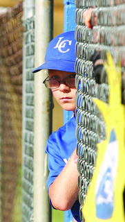 LaRue County's Zane Constant looked out of the dugout between innings during opening round action against Germantown in the 10-year-old West Kentucky Cal Ripken State Tournament.