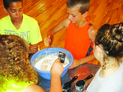 Nayland English, Heath Thompson, Ryan Brooke Puckett and AJ English mix up a batch of whole wheat bread.