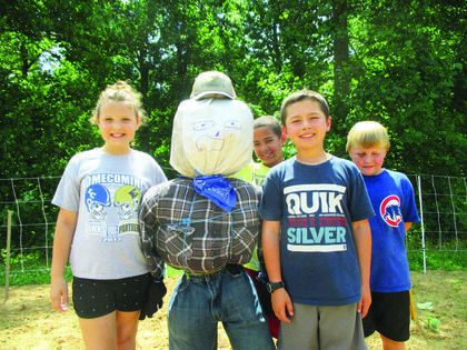 Ryan Brooke Puckett, Nayland English, Kaden Burd, and Thomas Ronkainen pose with their scarecrow.