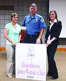 "The Elizabethtown Junior Woman's Club presented the Elizabethtown Fire Department with a $250 check from the Springtime Scramble 5K held in April. Above, Shelly Brackett, treasurer, and Loren Shawley, club member, presented the funds to Chuck Masterson with the EFD. The donation will be used for the ""shop with a firefighter"" program in December."
