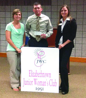The Elizabethtown Junior Woman's Club presented the Special Olympics of Hardin County with a $1,000 check from the Springtime Scramble 5K held in April. Above, Shelly Brackett, treasurer, and Loren Shawley, club member, presented the funds to Brandon Simpson with Special Olympics of Hardin County.