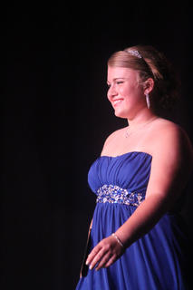 Emillee Cundiff is all smiles as she walks across the stage duirng the self-expression portion of the Distinguished Young Women program.