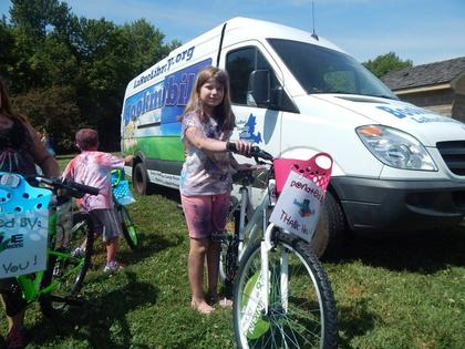 Emma Self of Magnolia won a bike donated by Beverly Whelan, CPA.