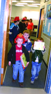 Toby Ashley, Tyler Ashley, J.D. Doughty and Mason Doughty carried the free books they earned by participating in the kindergarten readiness screening at Expo.
