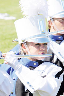 Lauren Zahrndt plays the flute for the Band of Hawks.