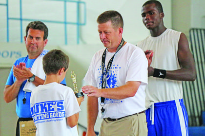 LaRue County Hawks Basketball Coach Paul Childress presented Gabe Crim with a trophy at Future Hawks Basketball Camp.