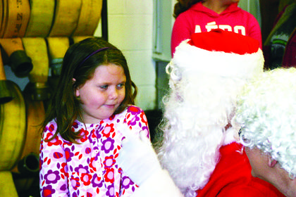 Lindsey Meredith, 7, seemed a bit skeptical of Santa.