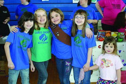 Girl Scouts Destiny Sallee, Jenna Longhofer, Alex Eskridge, Samantha Perkins and Savannah Perkins sold cookies at their booth at Expo.
