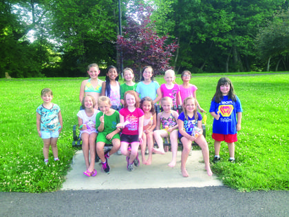 "Girl Scout Troop 1106 cooled off during their June 16 meeting at Creekfront Park with water balloons and Popsicles. They are planning a ""Reading Buddies"" event at 5:30 p.m. July 15 at the LaRue County Public Library for ages 2-7. This is part of their ""take-action"" project and all children are invited. They hope to make it an ongoing project. Front from left, Savannah Perkins, Arriana Rivera, Taylor Maupin, Bailey Litton, Chayne Pendleton, Destiny Despain, Saydee Darst, Marissa Muss; back, Cami Pendleton, Macy Stillwell, Kayla Maupin, Samantha Perkins, Rylee Harrison and Isabella Rivera. Not pictured is Donna Thompson."