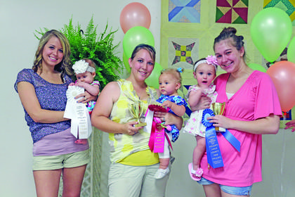 Winners of the Most Beautiful Little Girl Show, ages 6-12 months, were from left, third – Alissa Cummins, daughter of Alicia Cummings of Buffalo; second – Alison Nichole Hart, daughter of Nancy and Justin Hart of Hodgenville; and first – Tamryn Miller, daughter of Amanda Dobson and Jason Miller.