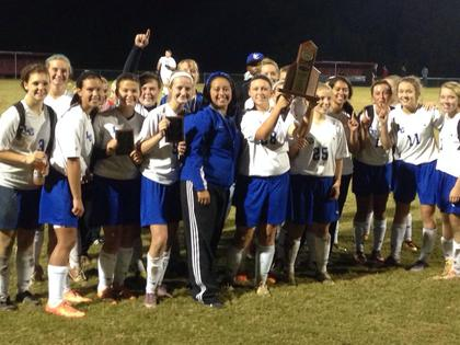 The Lady Hawks celebrate their district win.