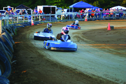 The go kart track at the rear of the LaRue County Fairgrounds was buzzing with competitors.