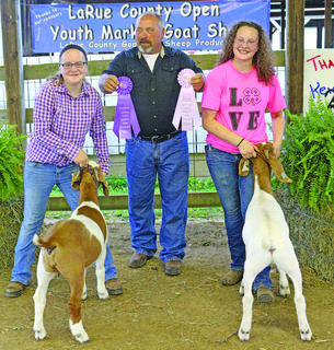 Mattie Bartley and Alicia Lee show off their winning goats.