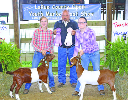 Meredith and Mattie Bartley pose for a picture with their winning goats.