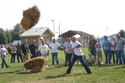 Glen Gardner takes his turn in the hay bale toss.