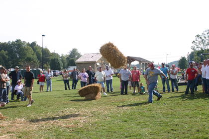 Rocky Cundiff threw a large hay bale in the Pioneer Games.