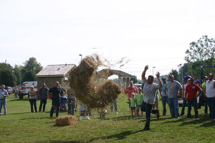 On his first attempt at the hay bale toss, Bill Thomas encounters a problem as his bale of hay unravels in mid-air.