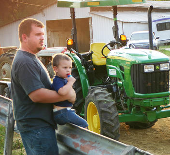 Blake Haysley, 2, and his dad, Dale Haysley, waited for the ATV races to begin Wednesday in front of the grandstand.