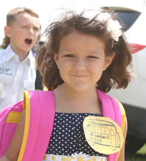 Chloe Zimmerman smiles as she leaves school on the first day. She's in kindergarten.