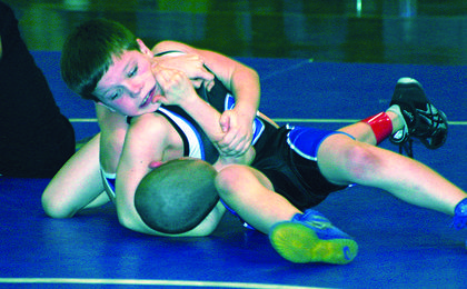 Fourth-grader Thomas Hoppes, top, bested his opponent, Blaine Frazier, of Campbellsville, Friday in a youth wrestling match. Hoppes is a student at Hodgenville Elementary School.