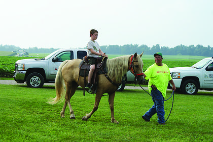 Grayson Miller rode a horse led by John Ray Ball at Ryan and Misty Bivens' farm.
